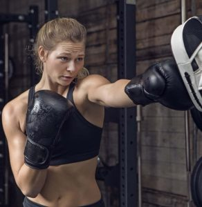 A Young Woman In Black Boxing