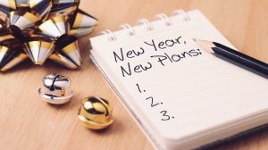 New year new plan with decoration. Discover how setting goals can bring more happiness in your life.