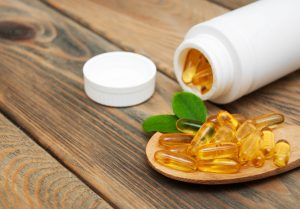 omega 3 supplement bottle and capsules