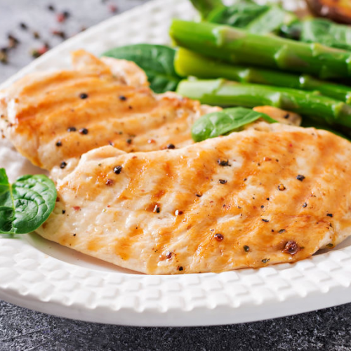 Baked basil chicken over fresh greens and asparagus recipe