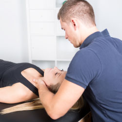 woman getting a chiropractic adjustment